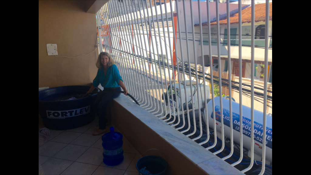 Madalena filling the container with fresh (FRESH) water